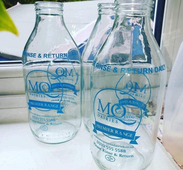 Empty glass milk bottles