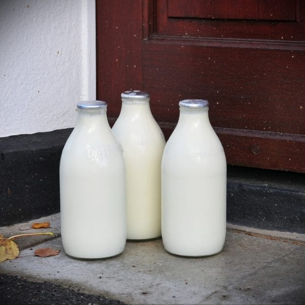 Glass Milk Bottles on a doorstep